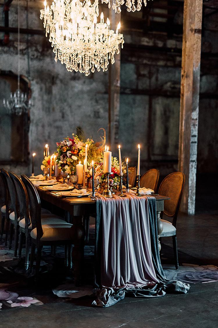 dramatic wedding tables - photo by Purple Tree Photography https://ruffledblog.com/dramatic-moody-wedding-inspiration-for-the-modern-bride