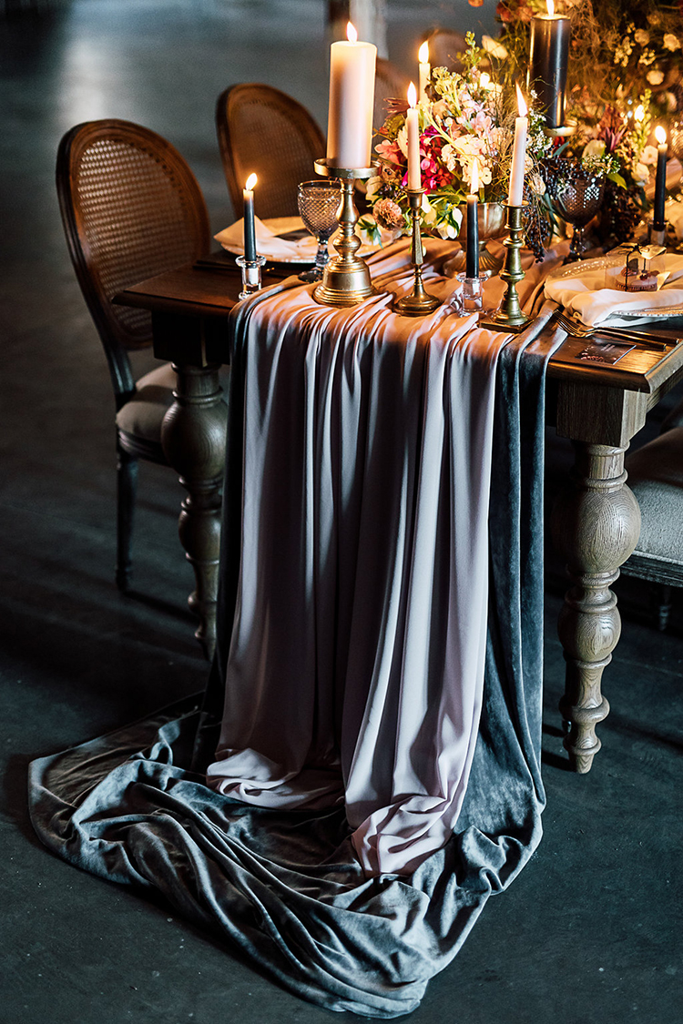 dramatic fabric table runners - photo by Purple Tree Photography https://ruffledblog.com/dramatic-moody-wedding-inspiration-for-the-modern-bride