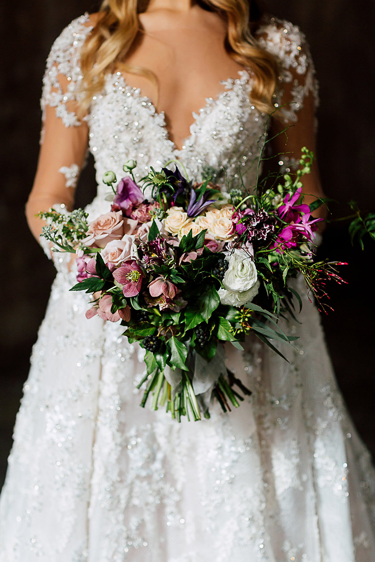 purple toned wedding bouquets - photo by Purple Tree Photography http://ruffledblog.com/dramatic-moody-wedding-inspiration-for-the-modern-bride