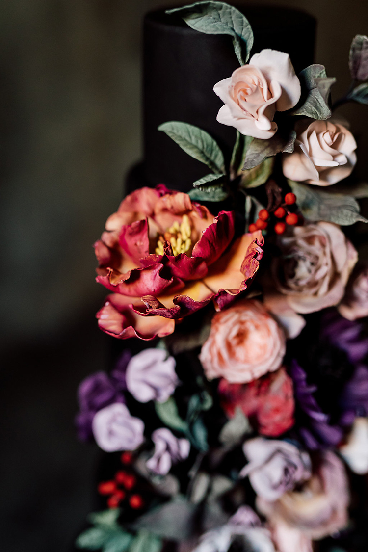 beautiful sugar flowers for cakes - photo by Purple Tree Photography https://ruffledblog.com/dramatic-moody-wedding-inspiration-for-the-modern-bride