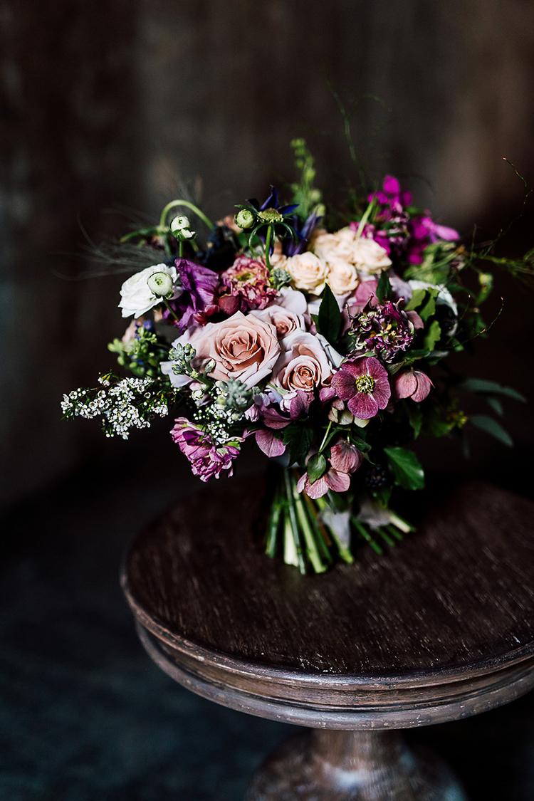 purple bouquets - photo by Purple Tree Photography https://ruffledblog.com/dramatic-moody-wedding-inspiration-for-the-modern-bride