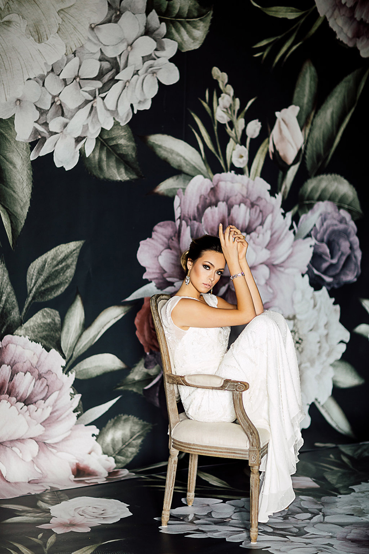 floral wallpaper backdrops - photo by Purple Tree Photography https://ruffledblog.com/dramatic-moody-wedding-inspiration-for-the-modern-bride