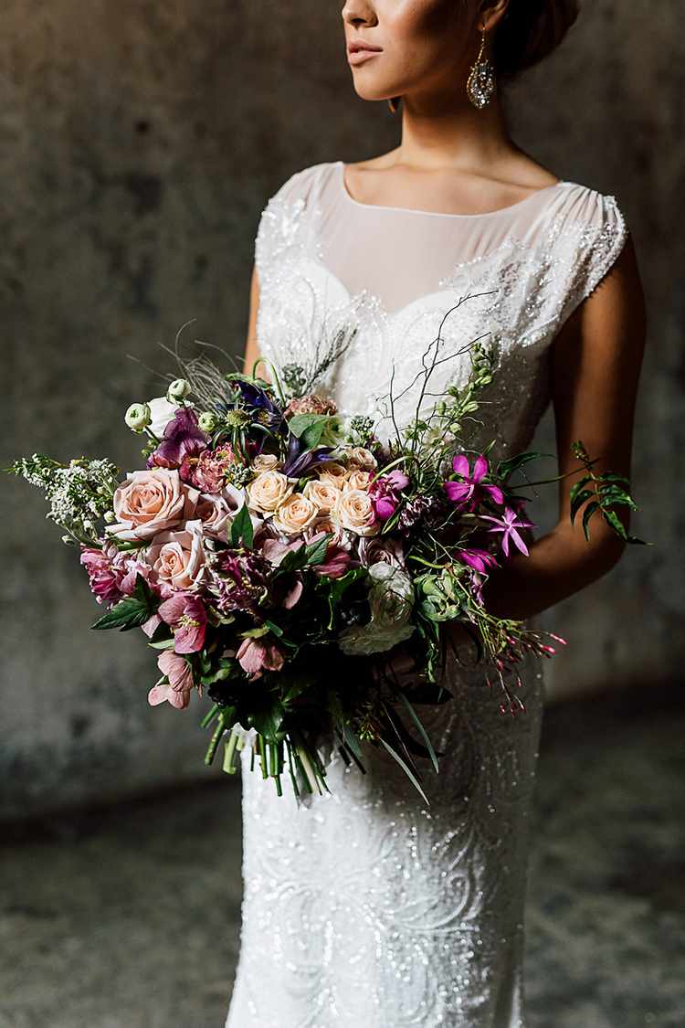 purple toned bouquets with greenery - photo by Purple Tree Photography https://ruffledblog.com/dramatic-moody-wedding-inspiration-for-the-modern-bride