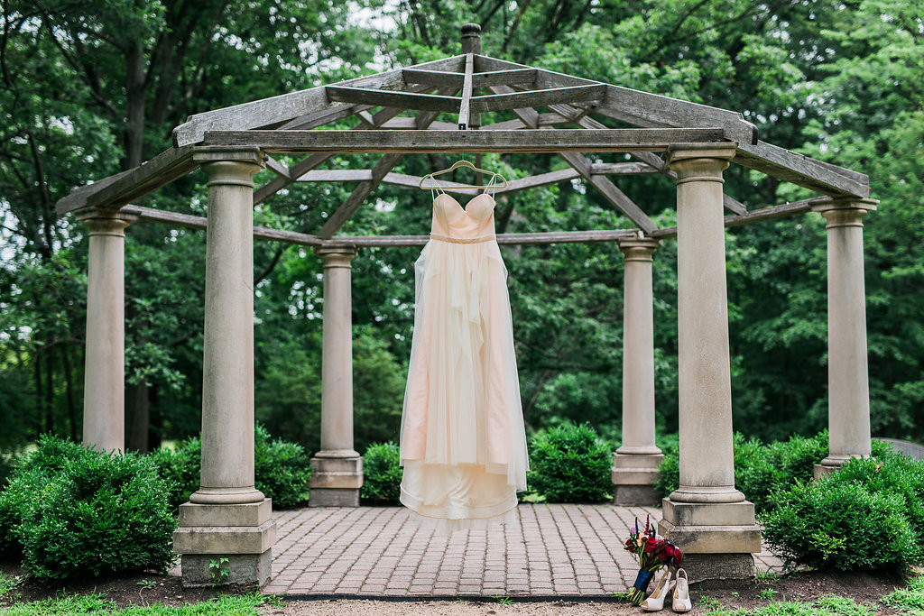 champagne colored wedding dresses - photo by Katie Ricard Photography http://ruffledblog.com/dramatic-woodland-wedding-inspiration-with-burgundy-accents