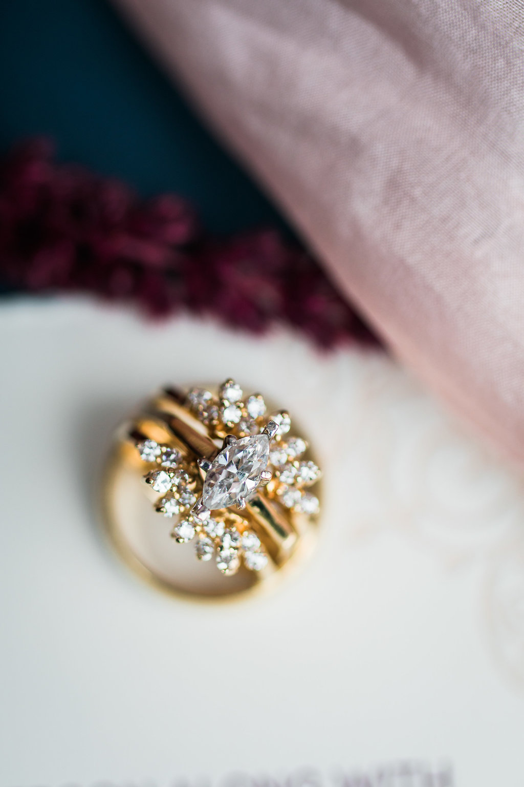 unique marquis cut engagement rings - photo by Katie Ricard Photography https://ruffledblog.com/dramatic-woodland-wedding-inspiration-with-burgundy-accents