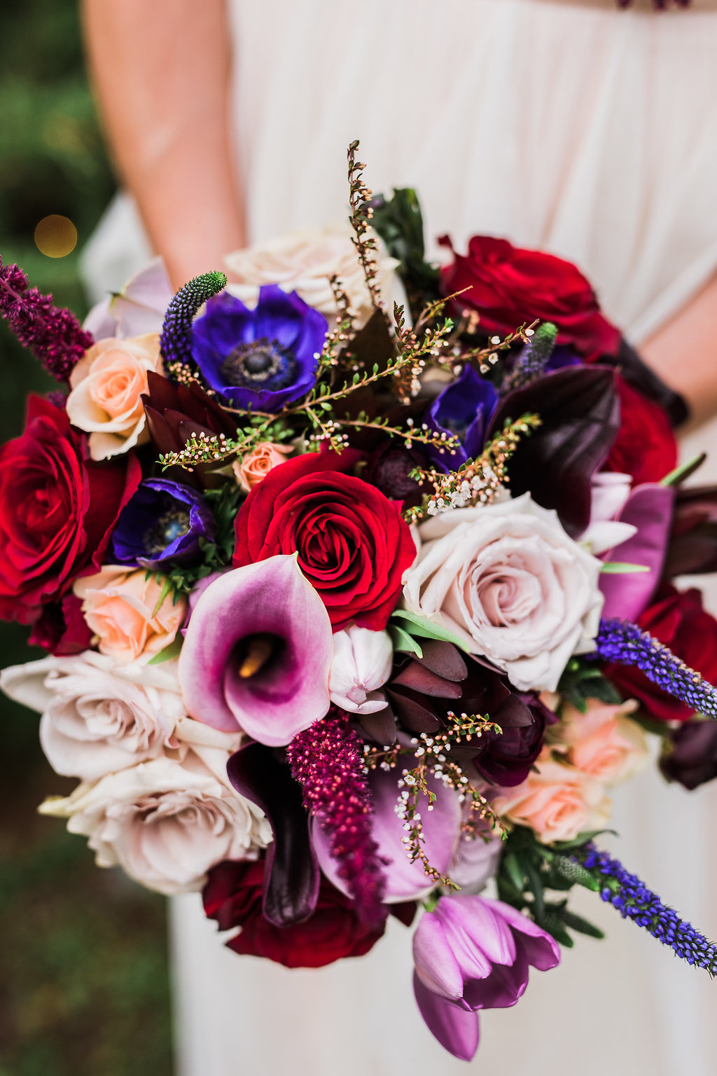colorful fall wedding bouquets - photo by Katie Ricard Photography https://ruffledblog.com/dramatic-woodland-wedding-inspiration-with-burgundy-accents