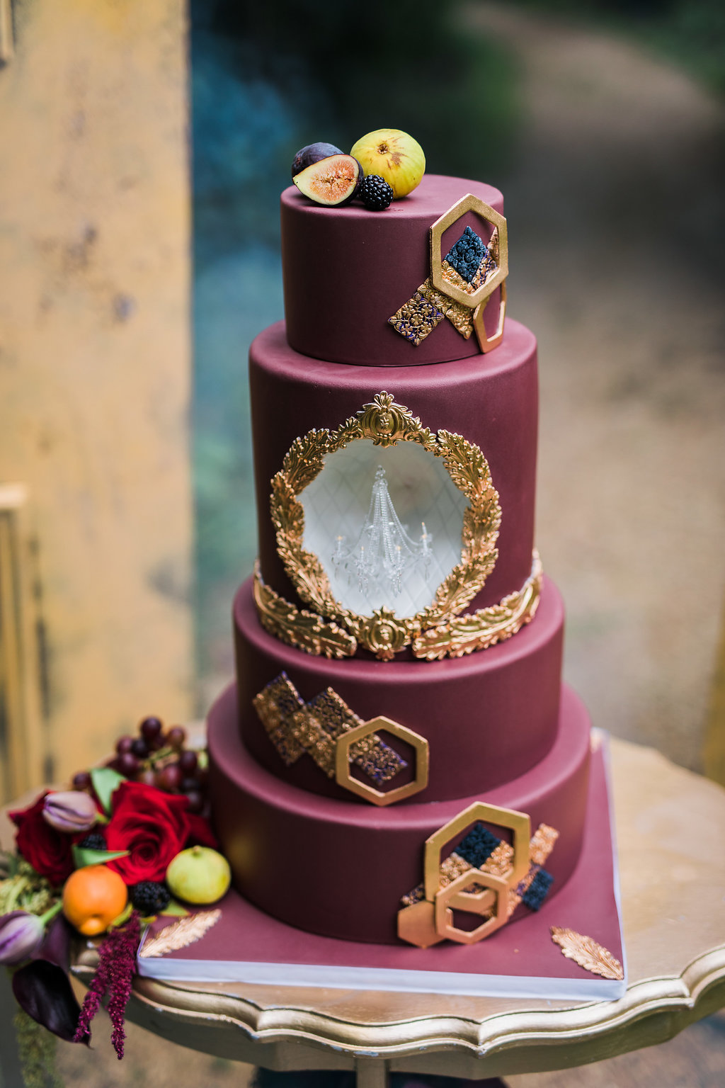 burgundy wedding cakes with chandeliers - photo by Katie Ricard Photography http://ruffledblog.com/dramatic-woodland-wedding-inspiration-with-burgundy-accents