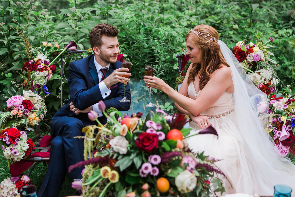 bride and groom - photo by Katie Ricard Photography https://ruffledblog.com/dramatic-woodland-wedding-inspiration-with-burgundy-accents