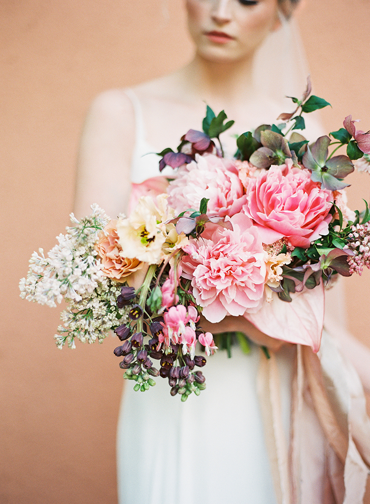 lush pink peony bouquets - photo by Kayla Barker Fine Art Photography https://ruffledblog.com/dreamy-tuscan-inspired-wedding-ideas-with-terracotta