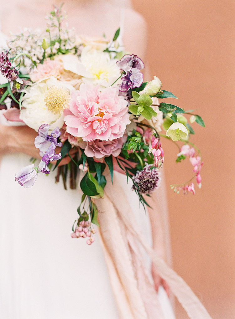 bouquets with pink peony - photo by Kayla Barker Fine Art Photography https://ruffledblog.com/dreamy-tuscan-inspired-wedding-ideas-with-terracotta