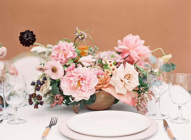 petite floral centerpieces - photo by Kayla Barker Fine Art Photography https://ruffledblog.com/dreamy-tuscan-inspired-wedding-ideas-with-terracotta