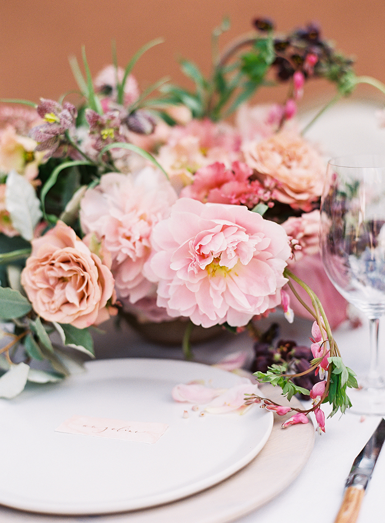 pink centerpieces - photo by Kayla Barker Fine Art Photography http://ruffledblog.com/dreamy-tuscan-inspired-wedding-ideas-with-terracotta