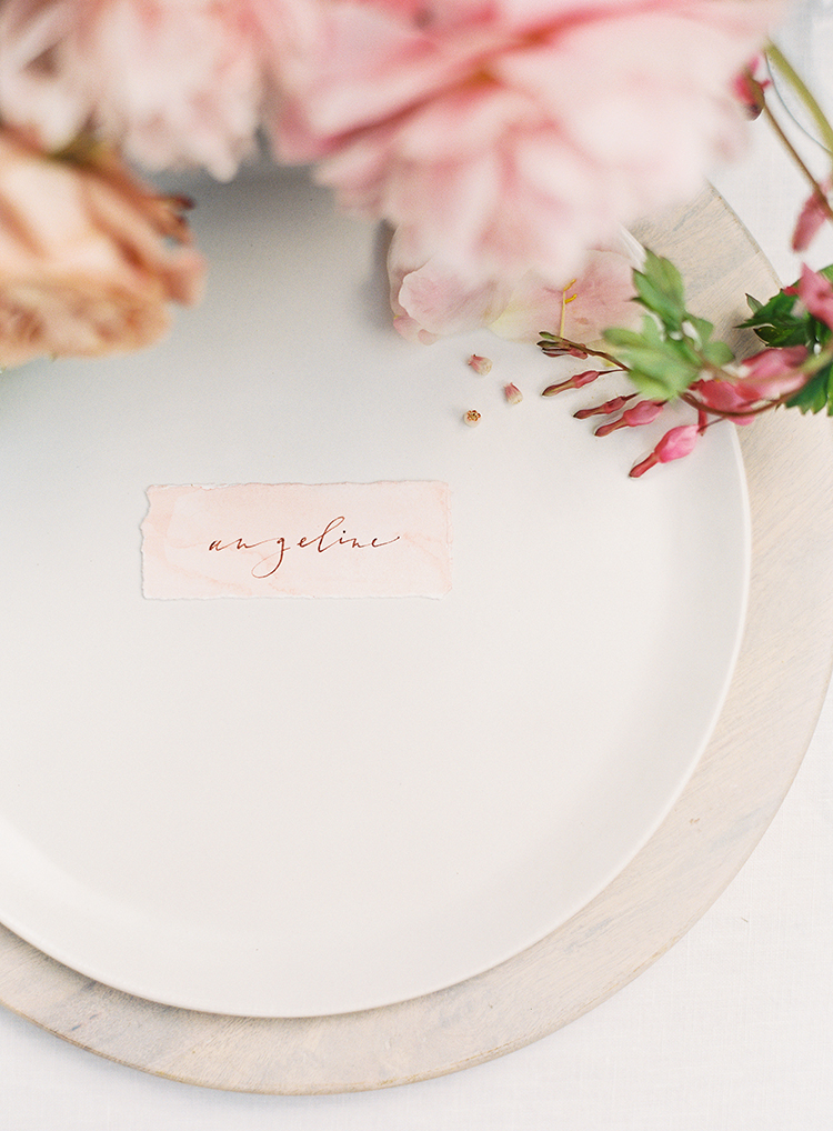 pink paper name cards - photo by Kayla Barker Fine Art Photography https://ruffledblog.com/dreamy-tuscan-inspired-wedding-ideas-with-terracotta