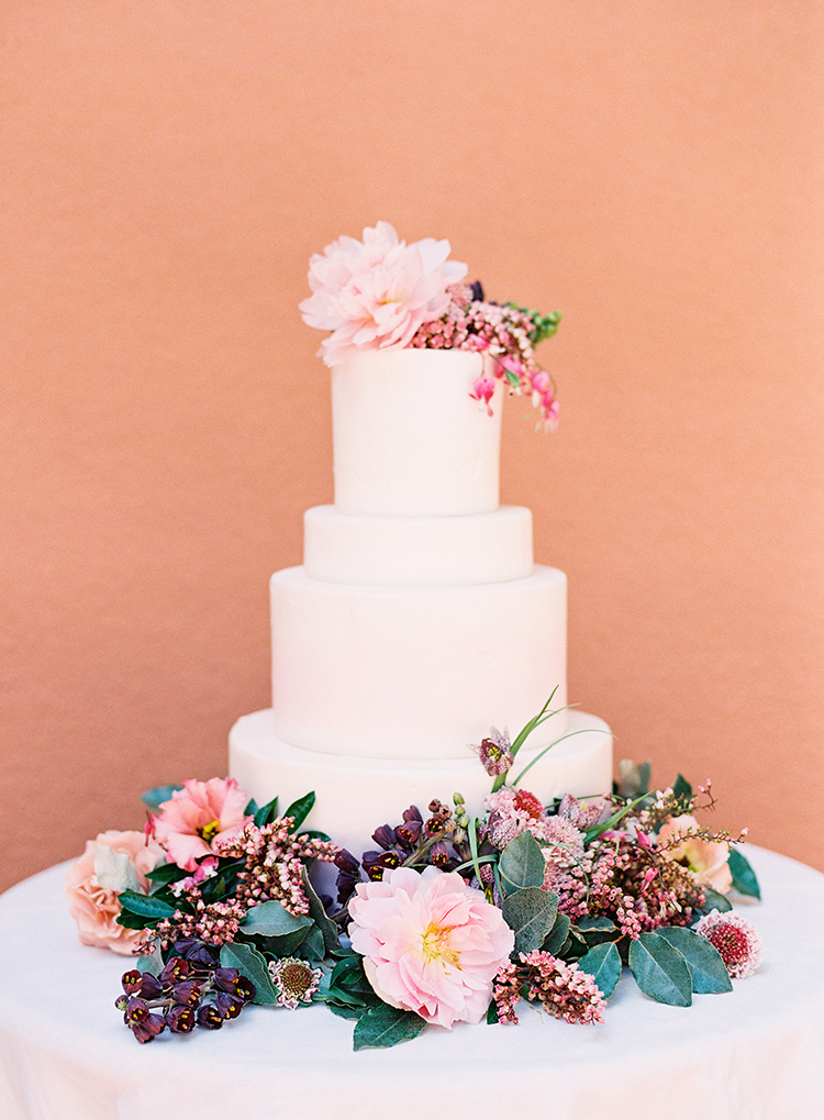 wedding cake with flowers - photo by Kayla Barker Fine Art Photography https://ruffledblog.com/dreamy-tuscan-inspired-wedding-ideas-with-terracotta
