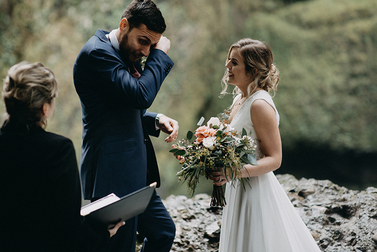 ceremony vows - photo by Minerva House Photography https://ruffledblog.com/dreamy-waterfall-elopement-at-wahclella-falls