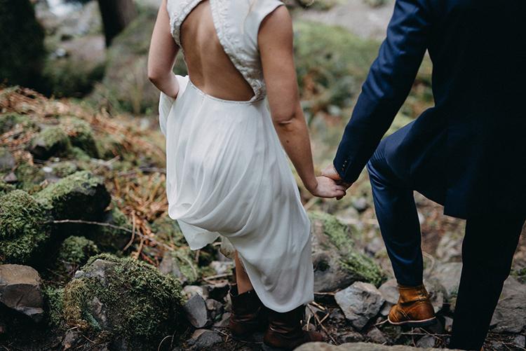 wedding dresses - photo by Minerva House Photography http://ruffledblog.com/dreamy-waterfall-elopement-at-wahclella-falls