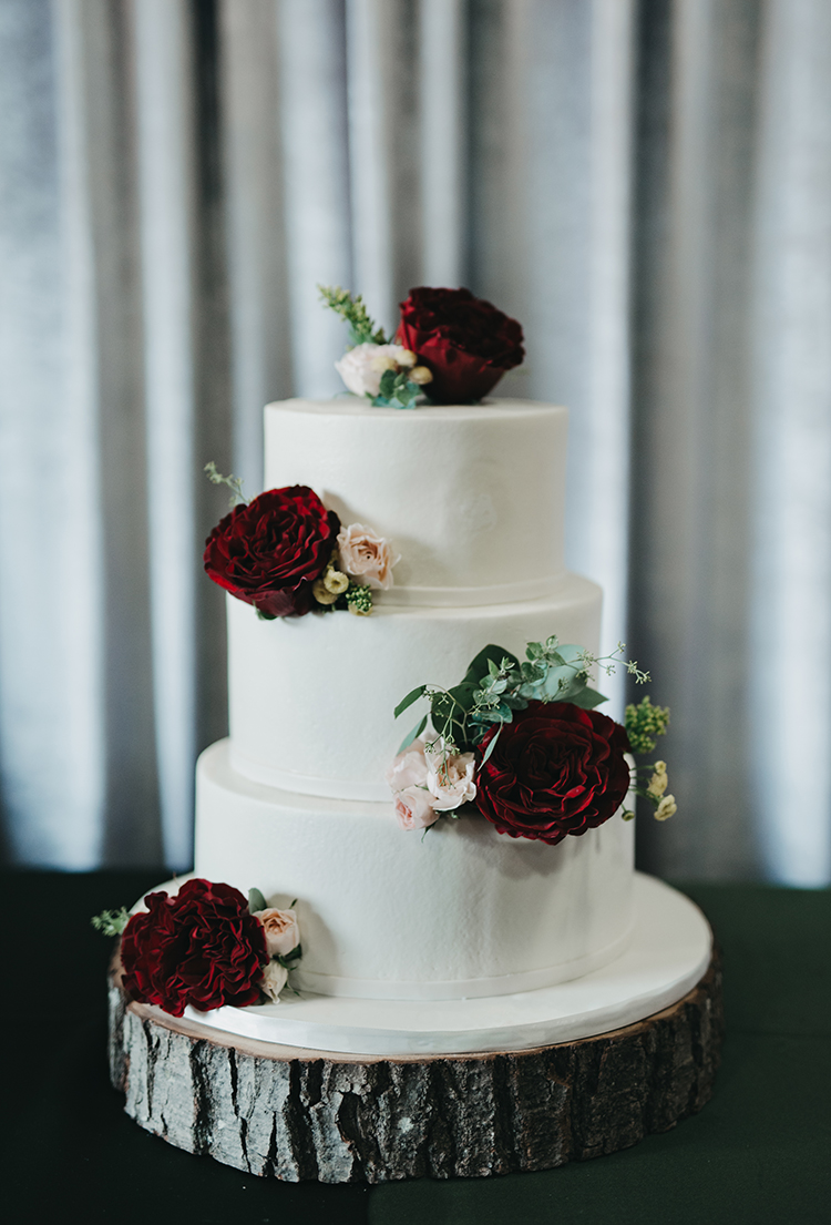 wedding cakes with red flowers - photo by Minerva House Photography https://ruffledblog.com/dreamy-waterfall-elopement-at-wahclella-falls