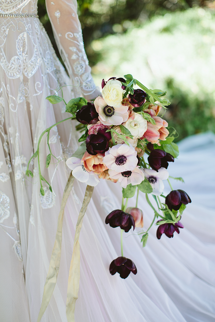 moody wedding bouquets with anemones - photo by Angela Zion Photography https://ruffledblog.com/dusty-toned-wedding-ideas-inspired-by-the-baltic-sea