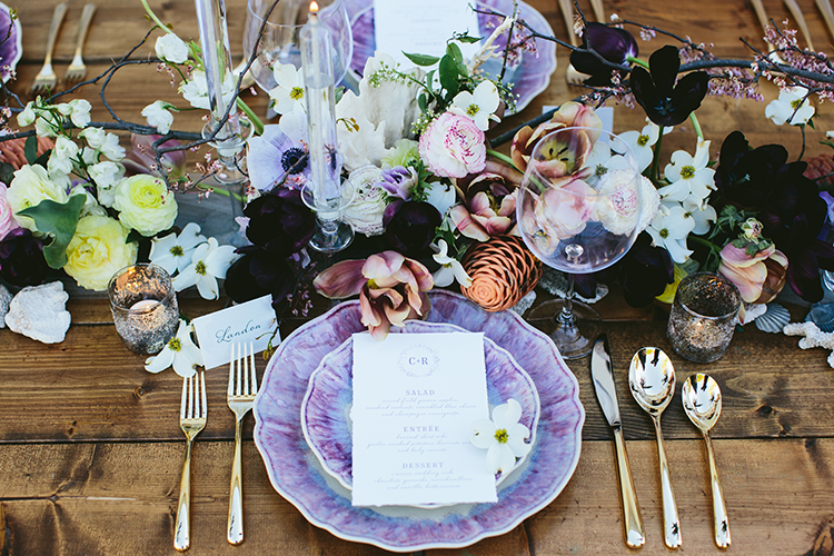purple wedding place settings - photo by Angela Zion Photography https://ruffledblog.com/dusty-toned-wedding-ideas-inspired-by-the-baltic-sea