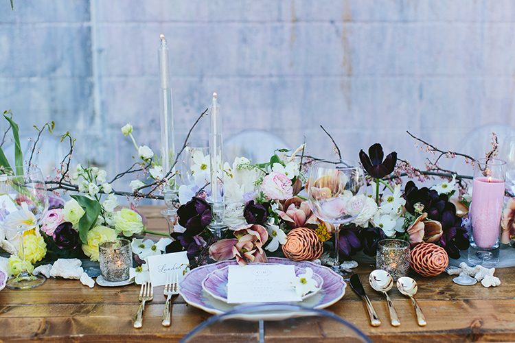 wedding tablescapes with flowers - photo by Angela Zion Photography https://ruffledblog.com/dusty-toned-wedding-ideas-inspired-by-the-baltic-sea