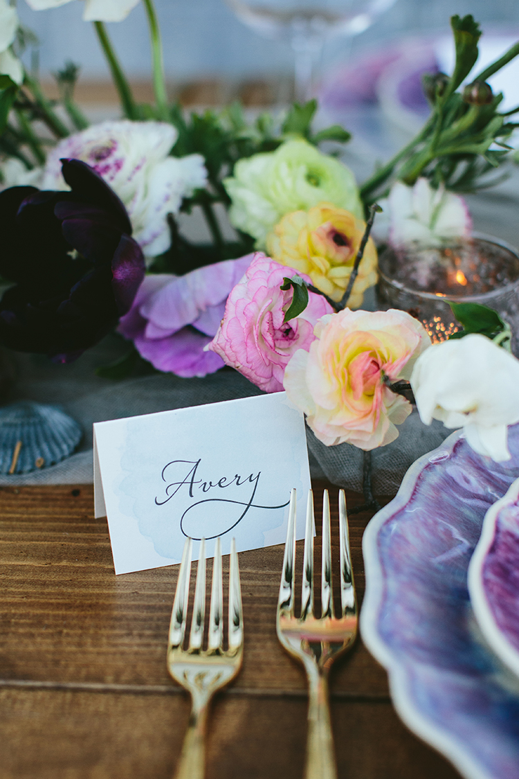 paper name cards - photo by Angela Zion Photography https://ruffledblog.com/dusty-toned-wedding-ideas-inspired-by-the-baltic-sea