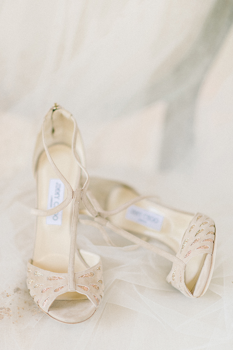 gold wedding shoes - photo by Elizabeth Fogarty https://ruffledblog.com/early-summer-wedding-inspiration-with-floral-displays