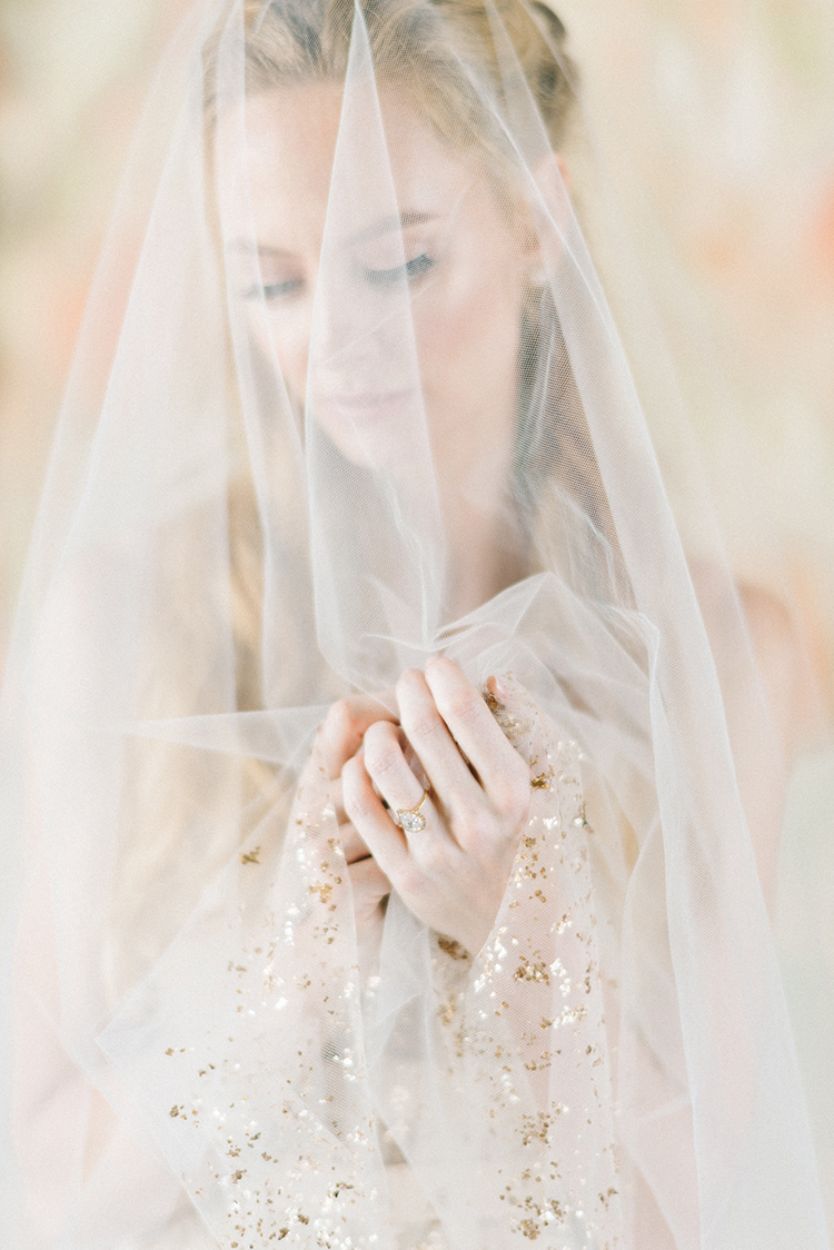 wedding rings and veils - photo by Elizabeth Fogarty http://ruffledblog.com/early-summer-wedding-inspiration-with-floral-displays