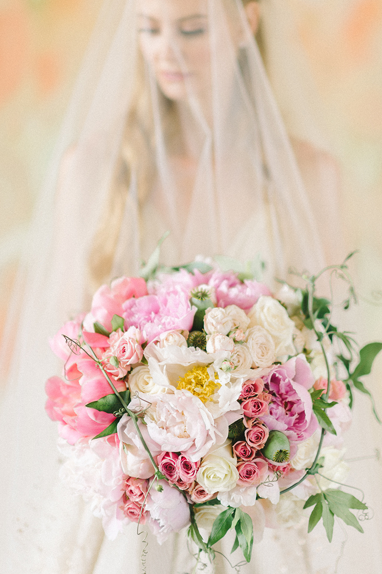 pink bouquets - photo by Elizabeth Fogarty https://ruffledblog.com/early-summer-wedding-inspiration-with-floral-displays