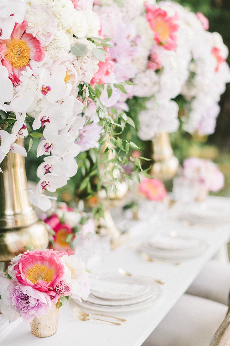 lush tablescapes - photo by Elizabeth Fogarty http://ruffledblog.com/early-summer-wedding-inspiration-with-floral-displays