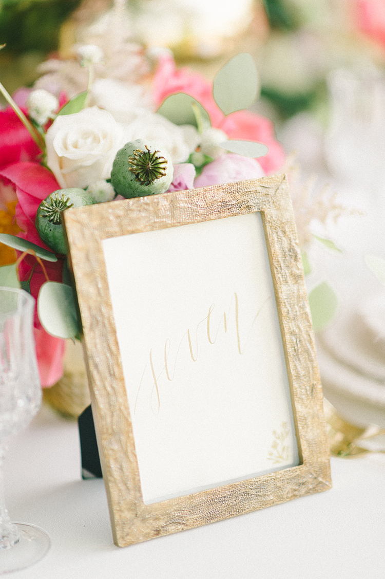 framed table numbers - photo by Elizabeth Fogarty http://ruffledblog.com/early-summer-wedding-inspiration-with-floral-displays