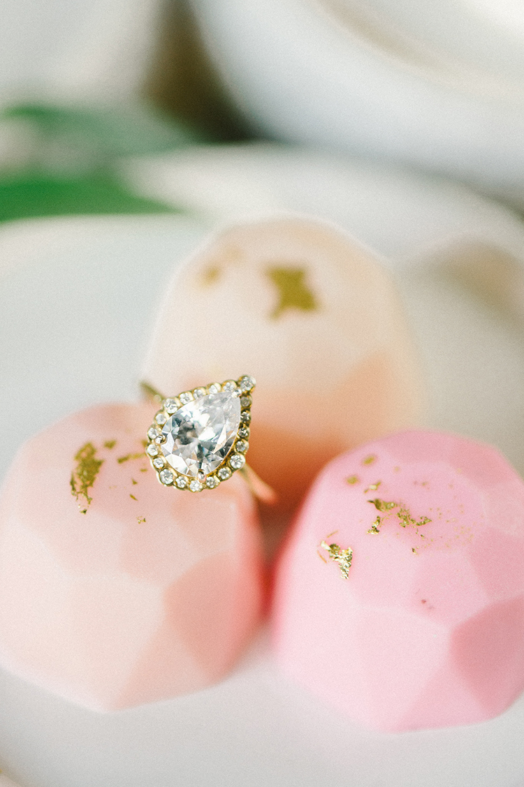 pear shaped diamond engagement rings - photo by Elizabeth Fogarty https://ruffledblog.com/early-summer-wedding-inspiration-with-floral-displays