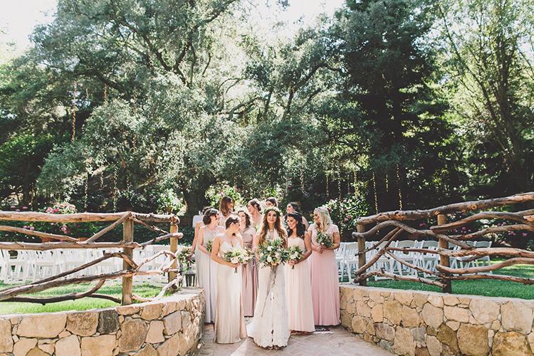 blush pink bohemian bridesmaid dresses - photo by Gina and Ryan Photography http://ruffledblog.com/eclectic-bohemian-wedding-at-calamigos-ranch