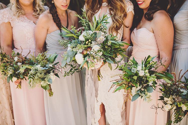 organic greenery bouquets - photo by Gina and Ryan Photography https://ruffledblog.com/eclectic-bohemian-wedding-at-calamigos-ranch