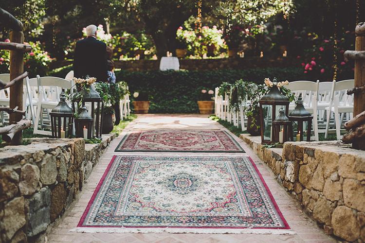 rugs at wedding ceremonies - photo by Gina and Ryan Photography https://ruffledblog.com/eclectic-bohemian-wedding-at-calamigos-ranch