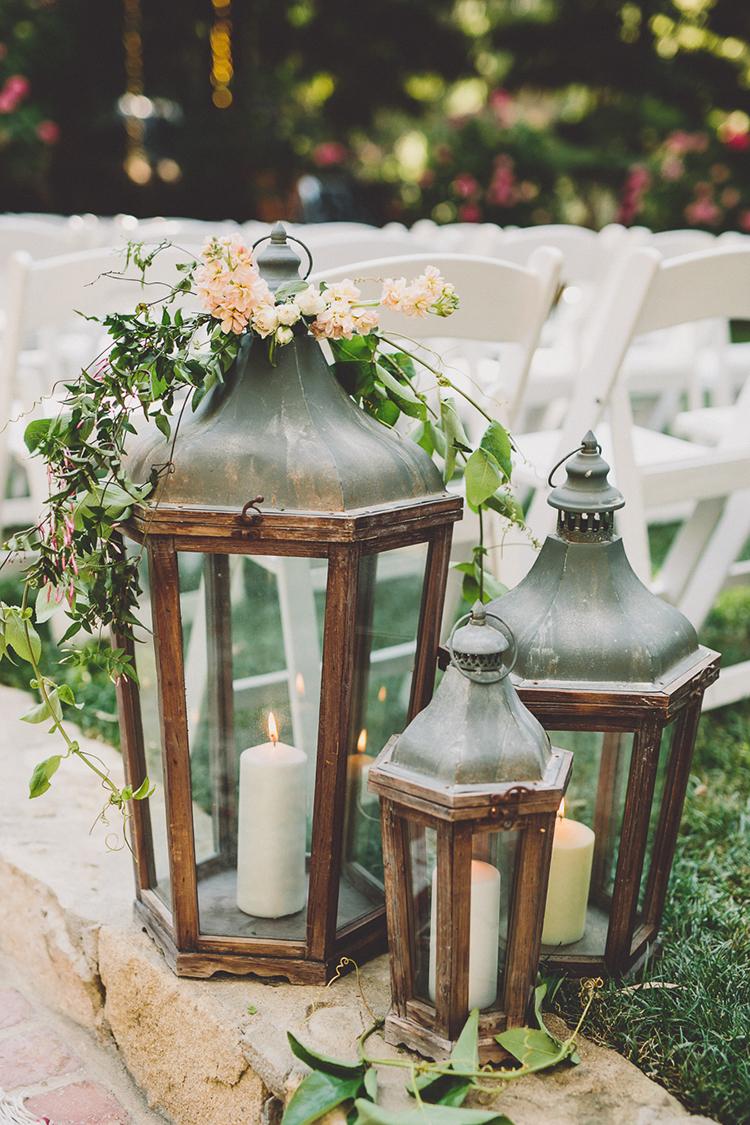 lantern wedding decor - photo by Gina and Ryan Photography http://ruffledblog.com/eclectic-bohemian-wedding-at-calamigos-ranch