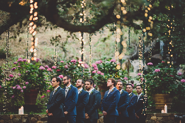 groomsmen during the ceremony - photo by Gina and Ryan Photography https://ruffledblog.com/eclectic-bohemian-wedding-at-calamigos-ranch
