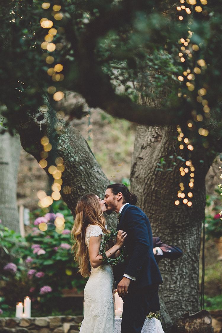 ceremony kiss - photo by Gina and Ryan Photography http://ruffledblog.com/eclectic-bohemian-wedding-at-calamigos-ranch