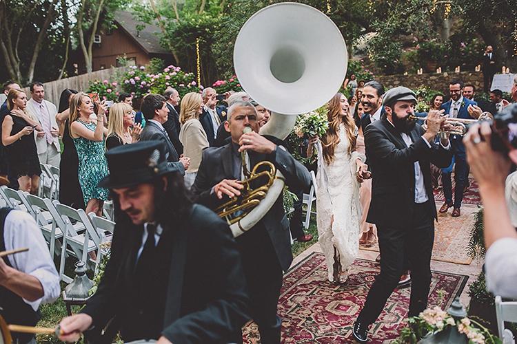 fun music at weddings - photo by Gina and Ryan Photography https://ruffledblog.com/eclectic-bohemian-wedding-at-calamigos-ranch