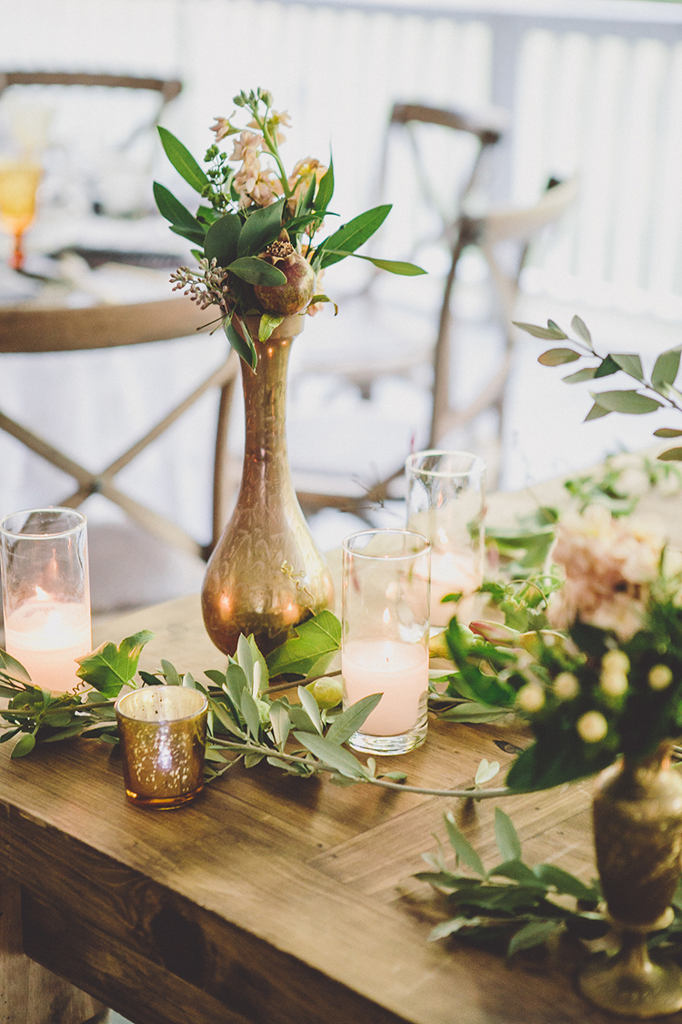 gold wedding centerpiece vases - photo by Gina and Ryan Photography http://ruffledblog.com/eclectic-bohemian-wedding-at-calamigos-ranch