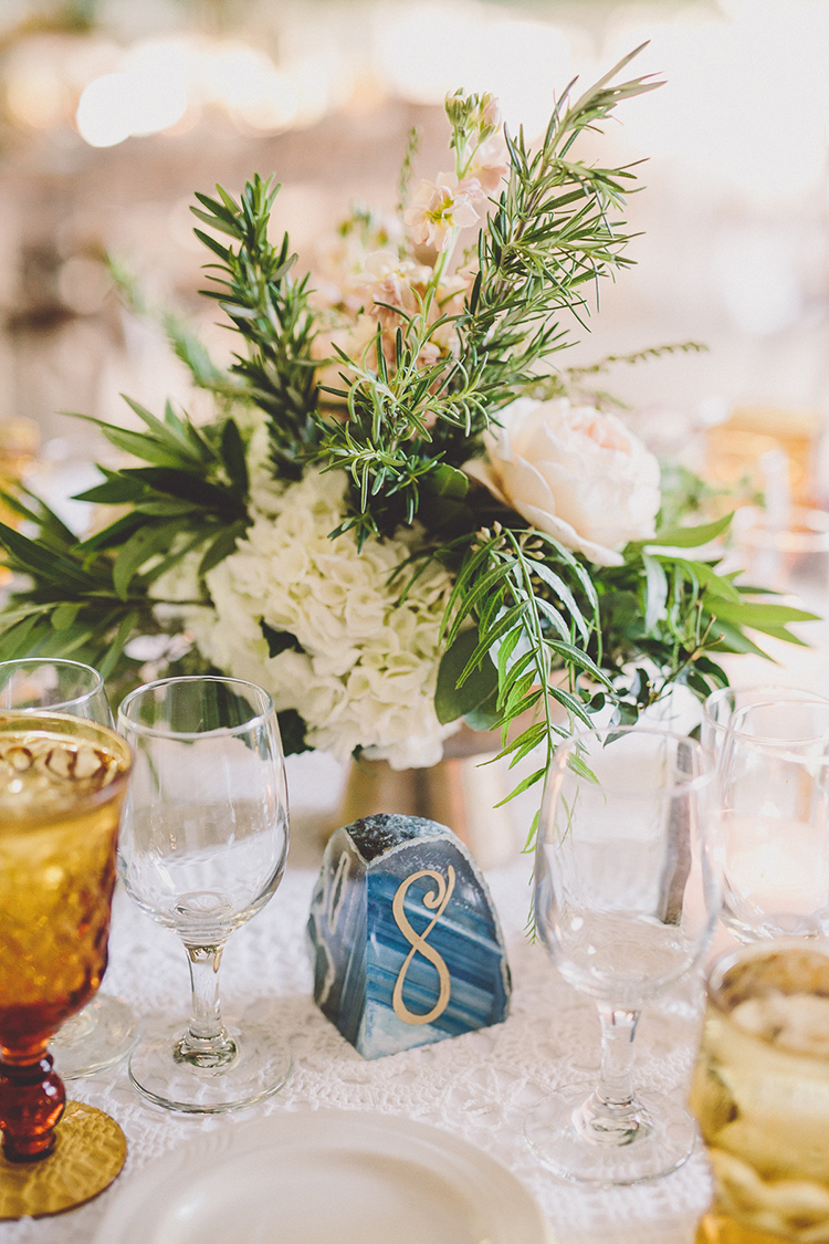 agate table numbers - photo by Gina and Ryan Photography http://ruffledblog.com/eclectic-bohemian-wedding-at-calamigos-ranch