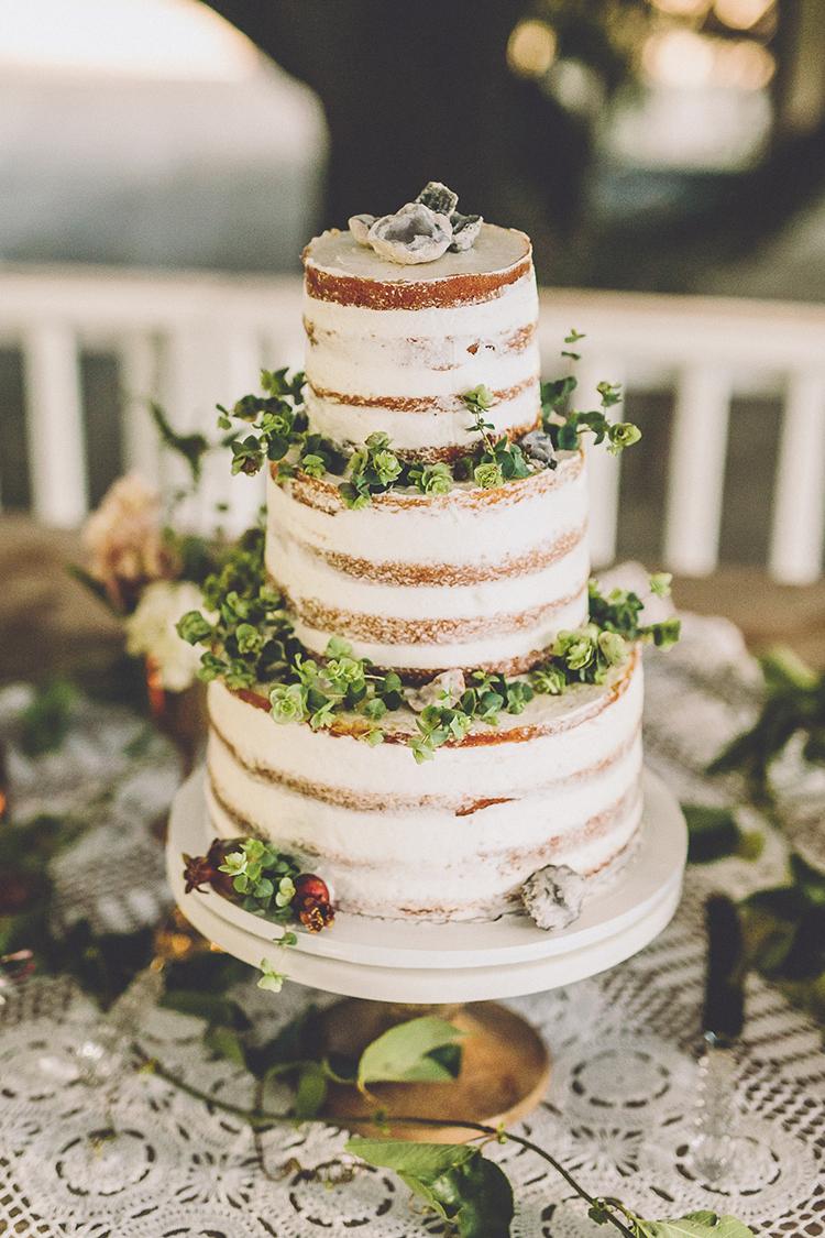 lightly iced wedding cakes - photo by Gina and Ryan Photography https://ruffledblog.com/eclectic-bohemian-wedding-at-calamigos-ranch