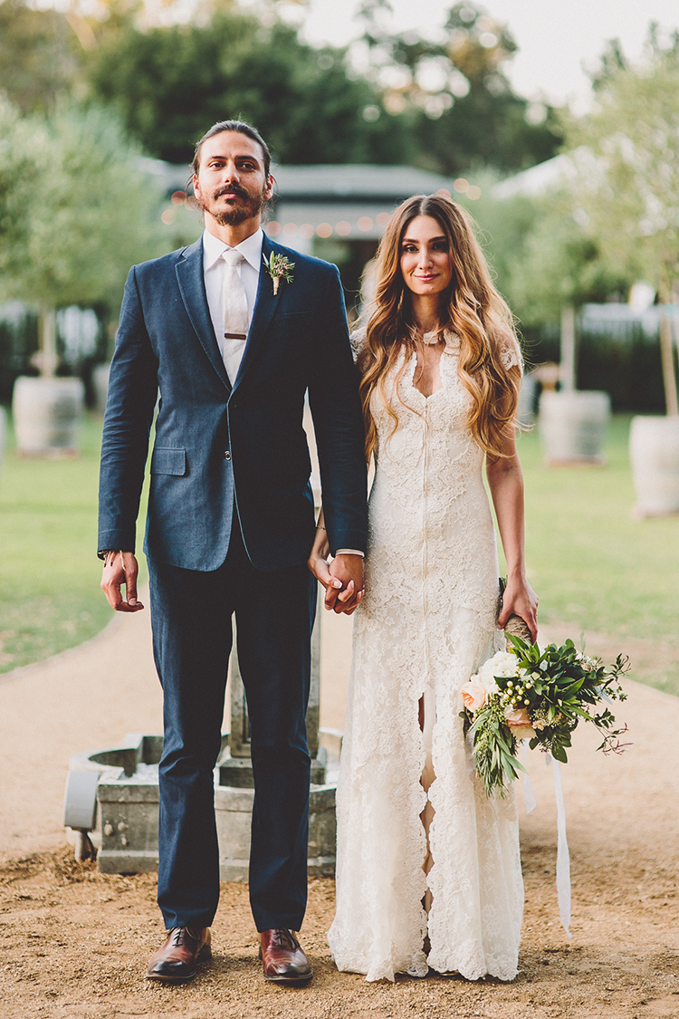 American Gothic inspired wedding portraits - photo by Gina and Ryan Photography https://ruffledblog.com/eclectic-bohemian-wedding-at-calamigos-ranch