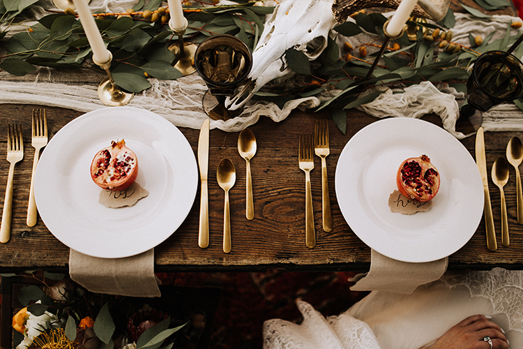 pomegranate place settings - photo by Chelsea Seekell Photography https://ruffledblog.com/eclectic-boho-desert-bridal-inspiration