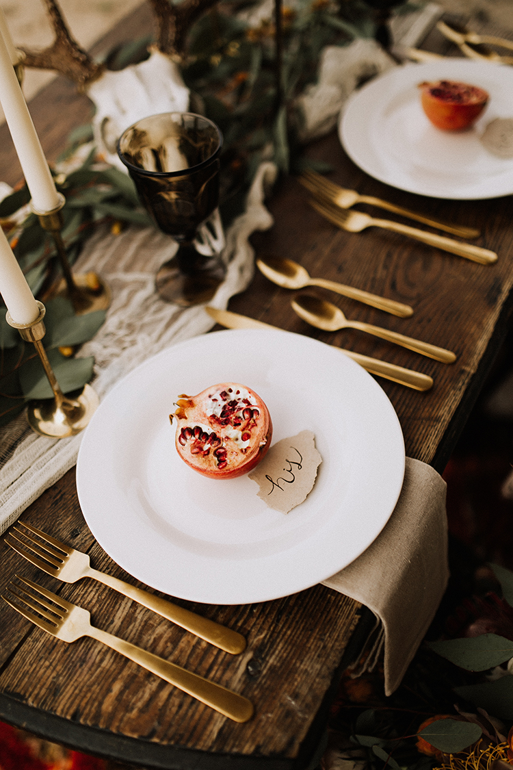tablescapes with pomegranates - photo by Chelsea Seekell Photography https://ruffledblog.com/eclectic-boho-desert-bridal-inspiration