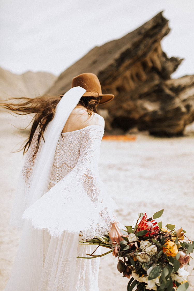 bohemian wedding dresses - photo by Chelsea Seekell Photography https://ruffledblog.com/eclectic-boho-desert-bridal-inspiration