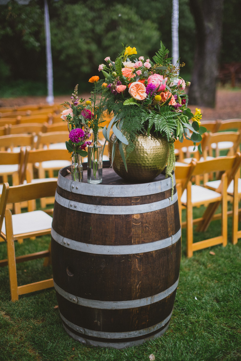 ceremony floral arrangements - https://ruffledblog.com/eclectic-rainy-day-wedding-with-moroccan-accents