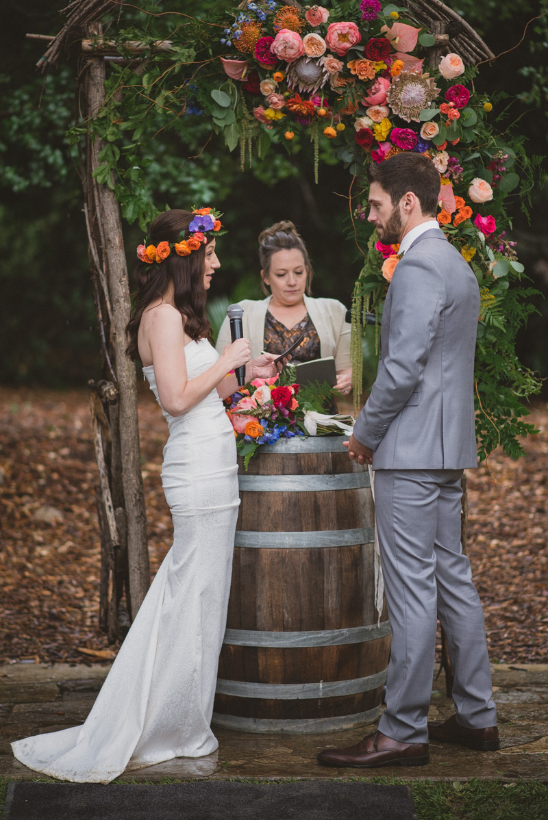 wedding ceremonies with floral arches - https://ruffledblog.com/eclectic-rainy-day-wedding-with-moroccan-accents