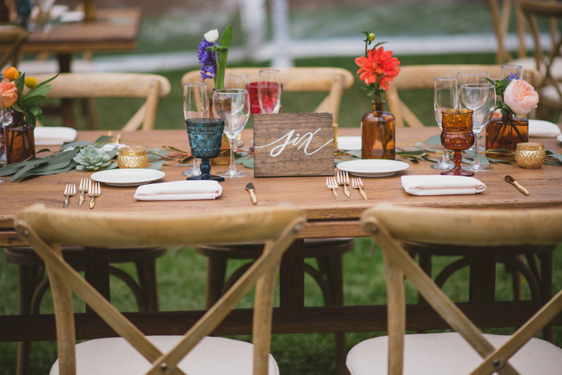 rustic wedding tables - https://ruffledblog.com/eclectic-rainy-day-wedding-with-moroccan-accents