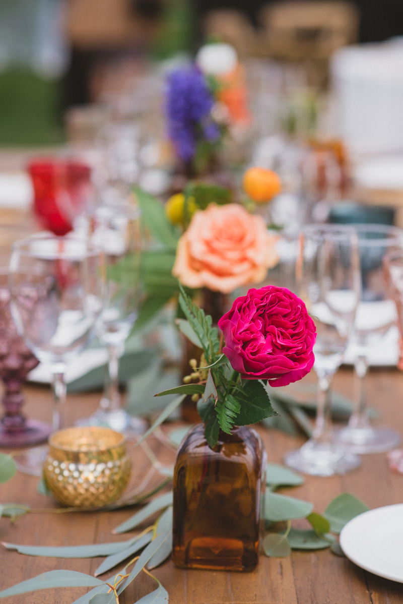 colorful bud vase arrangements - https://ruffledblog.com/eclectic-rainy-day-wedding-with-moroccan-accents