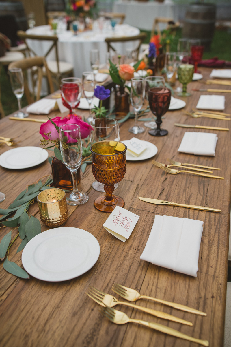 wedding tables with Moroccan accents - https://ruffledblog.com/eclectic-rainy-day-wedding-with-moroccan-accents